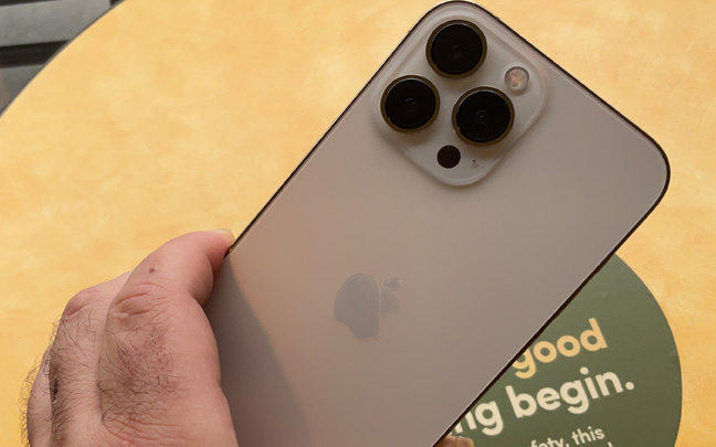 The iPhone 13 Pro Max has protruding lenses.